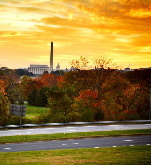 Golden skies at sunrise in Arlington, with the Washington Monument in the background.